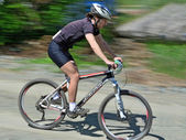 Descending bike rider - motion blur — Foto Stock