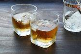 Glass of whiskey over ice — ストック写真