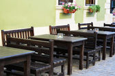 Outdoor street cafe tables and benches — Stock Photo