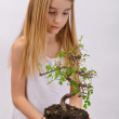 Girl with tree — Stock Photo