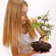 Girl sown plants — Stock Photo #21032083