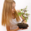 Girl sown plants — Stock Photo