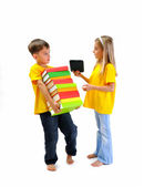 Boy carrying heavy books, girl shows him an e-book — Stock Photo