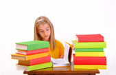 Education - beautiful girl reading a book surrounded by books, isolated on white — Stock Photo