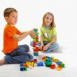 Two children boy and girl playing with constructor — Stock Photo #21111729