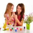 Two girls - sisters having fun painting Easter eggs — Stock Photo