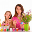 Two girls - sisters are preparing for Easter and painted eggs — Stock Photo