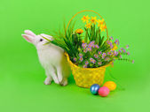 Easter - bunny, eggs and flowers on green — Stock fotografie