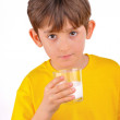 Boy drinking milk from glass cup — Stock Photo #23946979