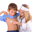 Kids-brother and sister playing doctor — Stock Photo #37911261