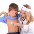 Stock Photo: Kids-brother and sister playing doctor