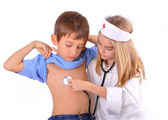 Kids-brother and sister playing doctor — Stock Photo