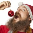 Santa Claus - eating Christmas Ball (series) — Stock Photo