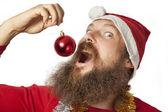 Santa Claus - eating Christmas Ball (series) — Stock Photo