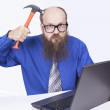 Angry businessman and hammer — Stock Photo #20730045