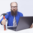 Stock Photo: Angry businessmand hammer