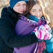 Young couple in winter day outdoor — Stock Photo