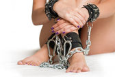Hands and Legs in shackles on white — Stock Photo