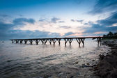 Silhouette of old pier in the sea — Stock Photo