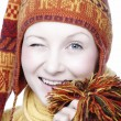 Winking woman in funny hat — Stock Photo