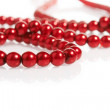 Red pearls on white — Stock Photo