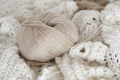 Hand-knitted fabric and yarn ball — Stock Photo