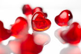 Red glass hearts — Stock Photo