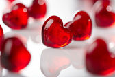 Many red glass hearts — Stock Photo