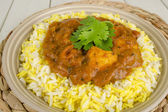 Chicken Bhuna and Bicolour Pilau Rice — Stock Photo
