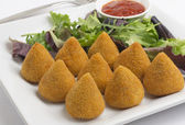 Brazilian deep fried chicken snack, popular at local parties. Served with salad and chili sauce. — Stock Photo