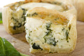Individual Goats Cheese and Spinach Quiches. — Stock Photo