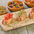 Stock Photo: Tapas on Crusty Bread