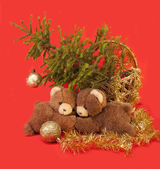 Teddy bears are under the Christmas tree — Stock Photo