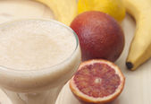Delicious smoothie of banana, orange and lemon. — Stok fotoğraf