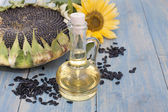 Sunflower seeds in the bag, and sunflower oil in a bottle — Stock Photo