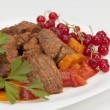 Stock Photo: Meat stew with vegetables and red currants
