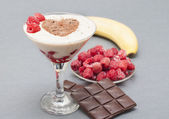 Cocktail of banana, raspberry and chocolate. — Stockfoto