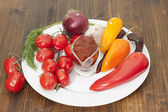 Sauce and vegetables peppers, tomato chili, garlic, onion on a w — Stock Photo