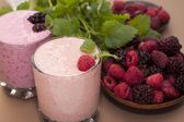 Yogurt with raspberries and blackberries and sprigs of mint . — Stock Photo