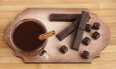 Hot chocolate in a glass cup and chocolate bars.  — Stock Photo