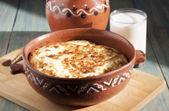 Omelet baked in ceramic pot.  — Stockfoto