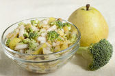 Fruit - vegetable salad of pears and broccoli.  — Stock Photo
