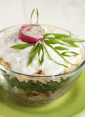 Radish salad with green onions, cheese, cottage cheese and cream — Stock Photo