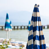 Off Season View of Closed Umbrella By the Beach In the Misty Mor — Stock Photo