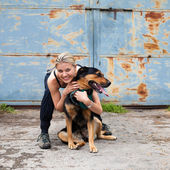 Pretty Young Girl in an Army Style Is Posing with Her Rottweiler — Stock Photo