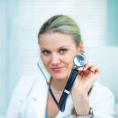 Pretty Young Female Doctor Is Holding a Black Stethoscope — Stock Photo