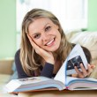 Pretty Young WomLying on Couch Reading Book — Stockfoto #15796537