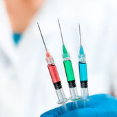 Scientist Holds Three Injection — Stock Photo