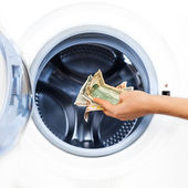 Crime Concept of Money Laundry: detail of a hand putting money — Stock Photo