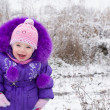 Portrait of happy little girl in snowy landscape — Stock Photo #16871155